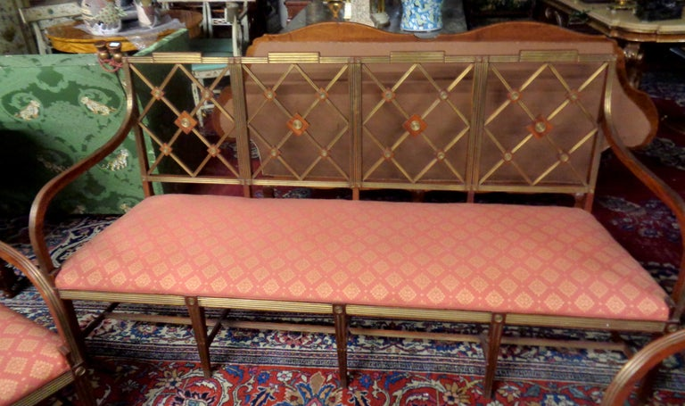 """Very fine Russian mahogany salon set with brass inlay consisting of tone upholstered settee and two matching armchairs. The set is in original condition with later upholstery, circa 1820.  Measures: Chairs:  Back height 37"""" Depth 19"""" Width 23"""
