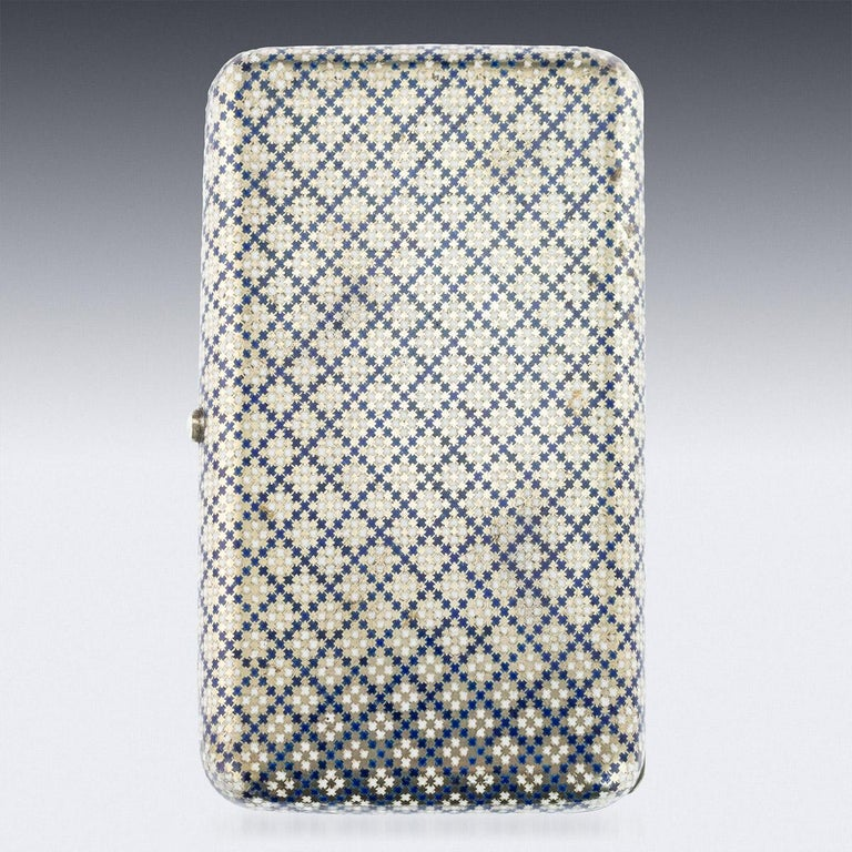 Antique 19th century Imperial Russian large solid silver and enamel cigar case, of rounded rectangular form, the surface enameled in opaque blue and white diaper, the lid engraved with a vacant cartooche within scalloped foliate borders, the