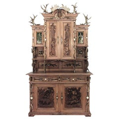 19th Century Rustic German Oak Hutch Ornamented with Horns and Stained Glass