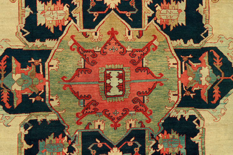 An extraordinary, authentic late 19th century Persian Heriz Serapi rug.   The Serapi rug can be traced back to the beginning of Persian handmade rug production in 5,500 B.C., but it was not until the mid-19th century that Persian rugs began to be