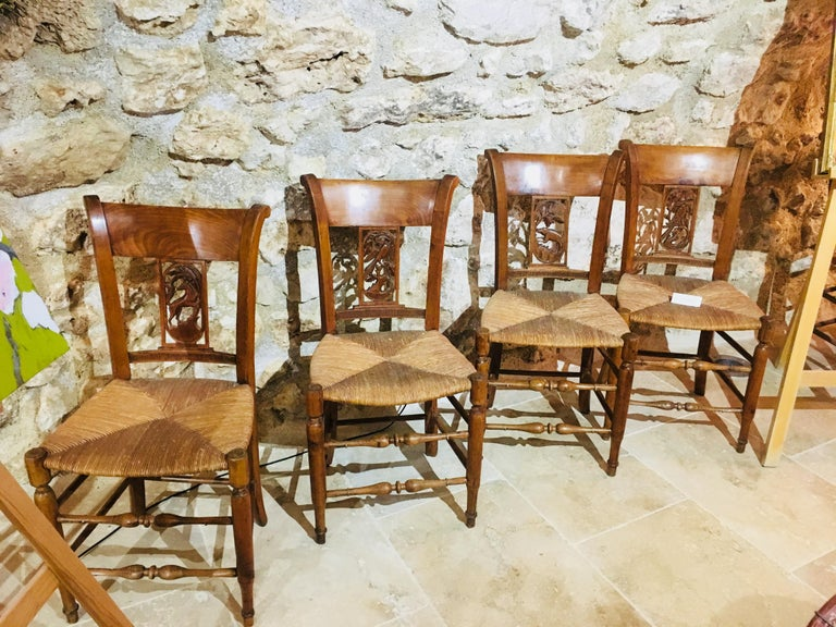 19th century set of eight wooden hand-carved chairs with cane seats.