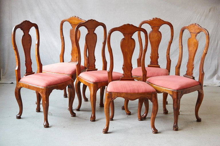 Fine set of six Louis XIV French Country style carved walnut chairs, France, circa 1840. Each chair with a vase-shaped splat flanked by serpentine stiles, with drop-in seats above cabriole legs standing on pad feet. The fabric has a few stains,