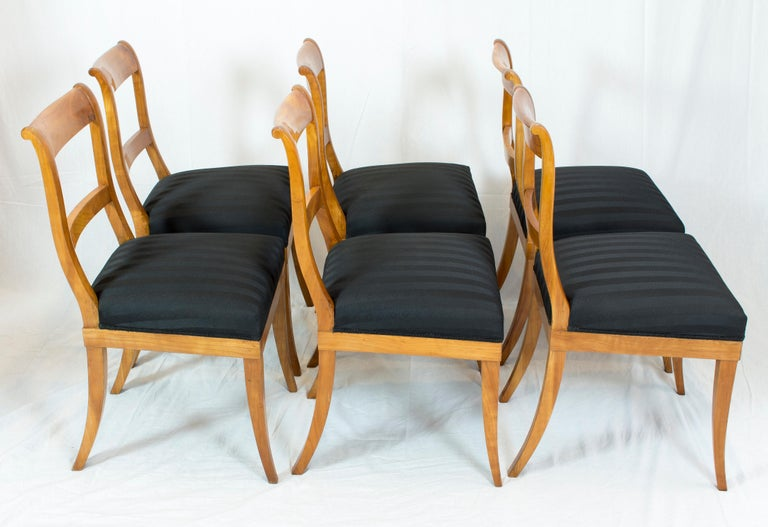 A beautiful set of six chairs from the Biedermeier period, circa 1825. The chairs are made of solid cherrywood and newly upholstered. The chairs are in a very good restored condition. The seat height is 48 cm.