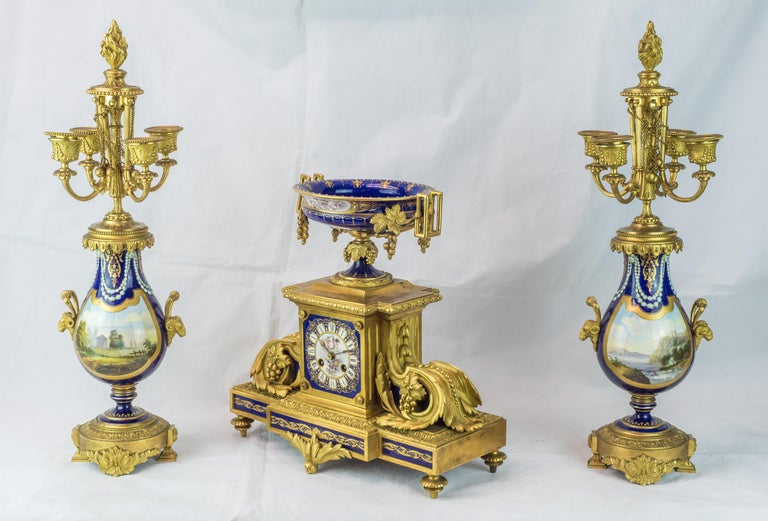 A magnificent Sèvres style gilt bronze and cobalt-blue 'Jeweled' painted porcelain clockset.