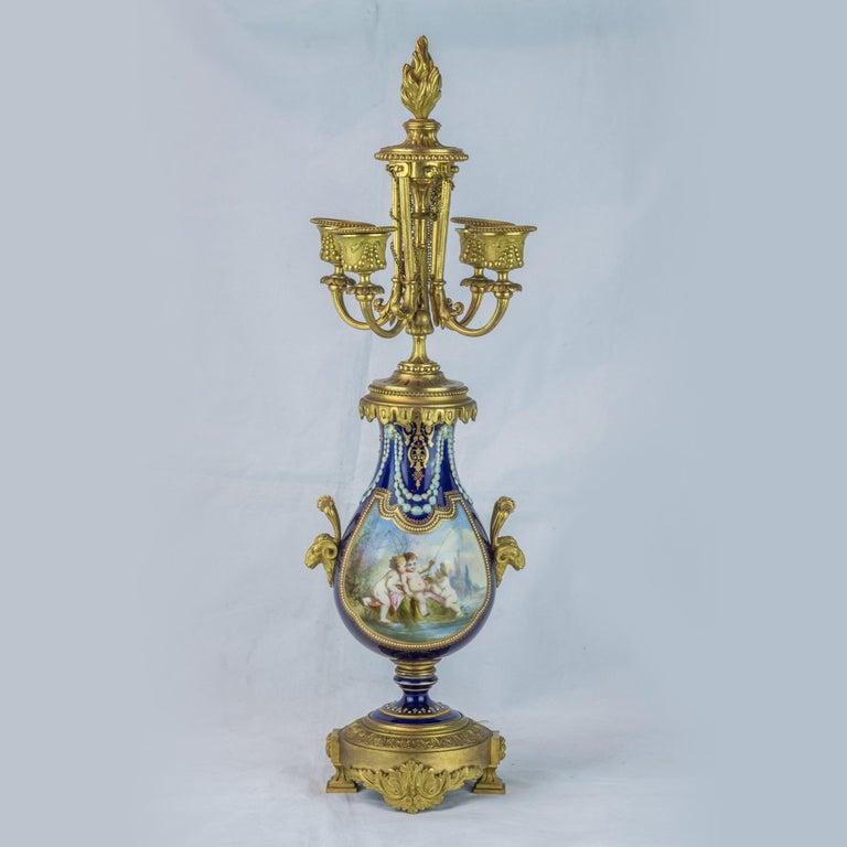 Gilt 19th Century Sèvres Style Ormolu and Cobalt-Blue Painted Porcelain Clockset For Sale