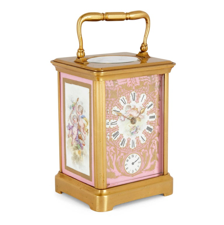 Rococo Style Sevres Style Porcelain and Ormolu Carriage Clock French, late 19th Century Dimensions: Height 18cm, width 10cm, depth 8.5cm  The carriage clock is of rectangular form and is crafted with a rectangular ormolu case set with Sevres style