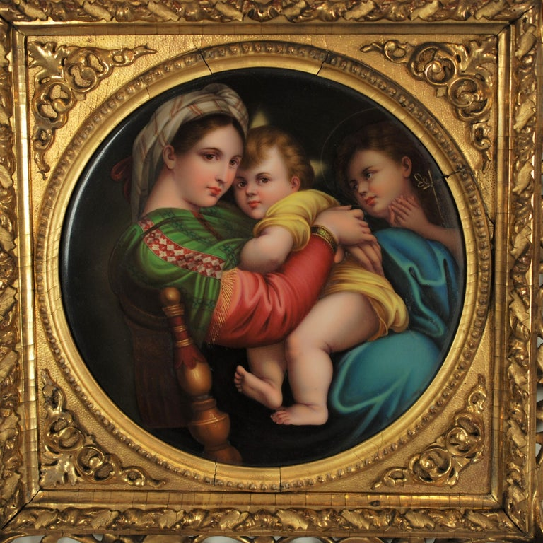 This outstanding hand painted 19th century round porcelain plaque is after Raphael's Renaissance masterpiece Madonna Della Seggiola. The artwork depicts an intimate scene featuring the Virgin Mary seated in a chair while embracing the baby Jesus in