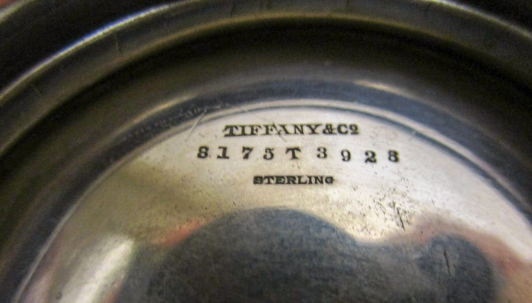 This delightful vine pattern sterling silver bowl by Tiffany features a daisy motif around the top side rim, and is monogrammed Margaret Foster Smith 1893. The piece is marked on the bottom Tiffany & Co. 8175T3928- 1 1/2 pints. Authentic Tiffany
