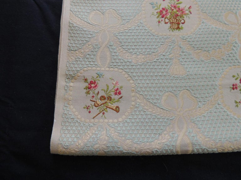 19th century silk brocade floral gold and celadon textile panel. Overall pattern of garlands, bows, tassels and floral bouquets inside an urn. Ideal for pillows or upholstery. Size: 22