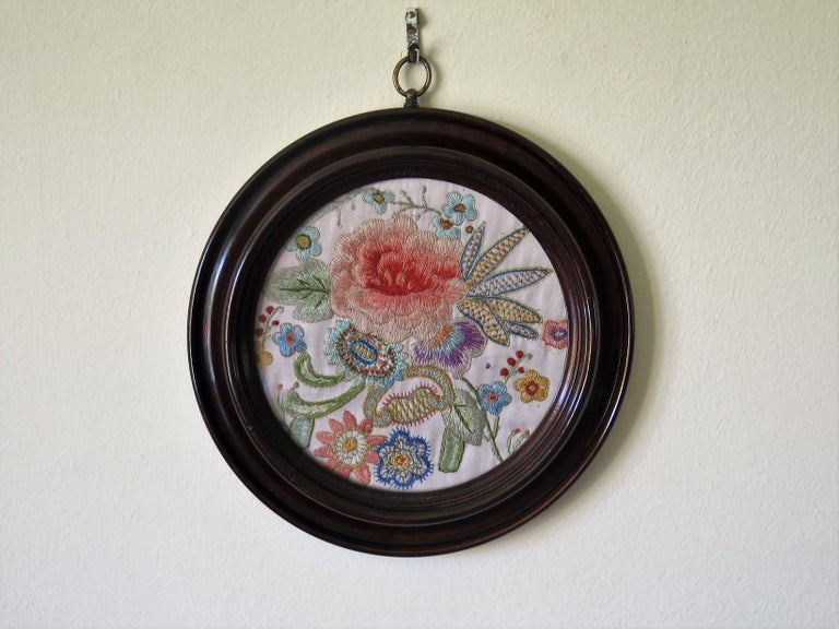 This is a beautifully hand embroidered, needlepoint, silk tapestry panel in a mahogany turned frame dating to the mid-19th century Victorian period, circa 1850.  The tapestry panel is finely hand embroidered on silk with fine needlepoint stitching