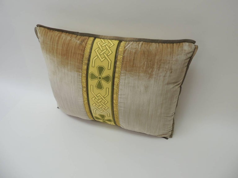 19th century silk golden velvet with French silk woven ribbon throw pillow Bolster throw pillow handcrafted with golden estrie silk velvet framed with a French green and gold woven embroidered deco inspired trim. Art Deco style trim exhibits a