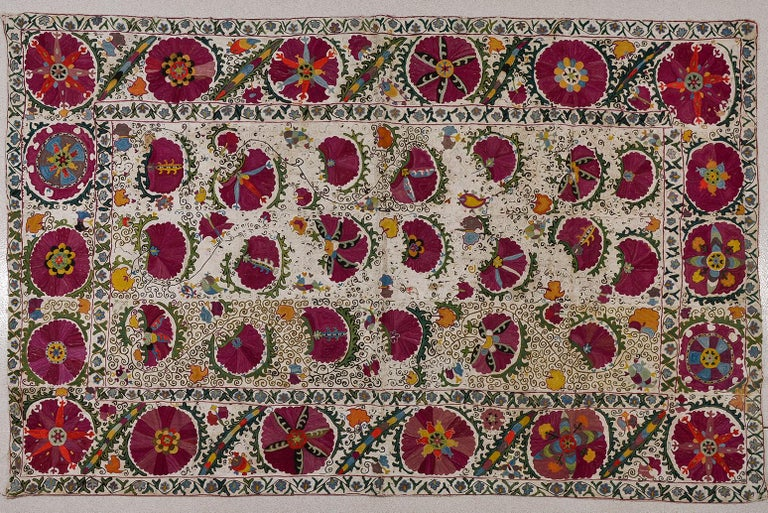 This ancient piece was embroidered in the surroundings of the ancient central city of Bokhara, on the Silk Road. Many shades of green were used (sacred color), even the blue. The yarns are dyed with vegetables substances, but the black color was