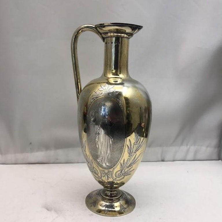 19th century silver and gilt ewer with matching goblets. A superb antique sterling silver wine jug with a shaped vase form on rounded foot. Fantastic quality from top to toe, just as you'd expect from this well known silver maker. Both the goblets
