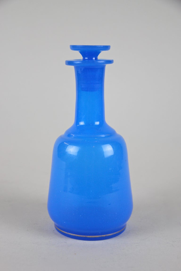 Blown Glass 19th Century Sky Blue Glass Bottle Biedermeier Mouth Blown, Austria, circa 1840 For Sale
