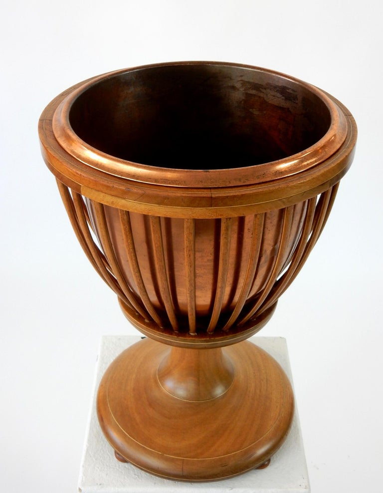 19th century slatted inlaid mahogany planter with copper liner.