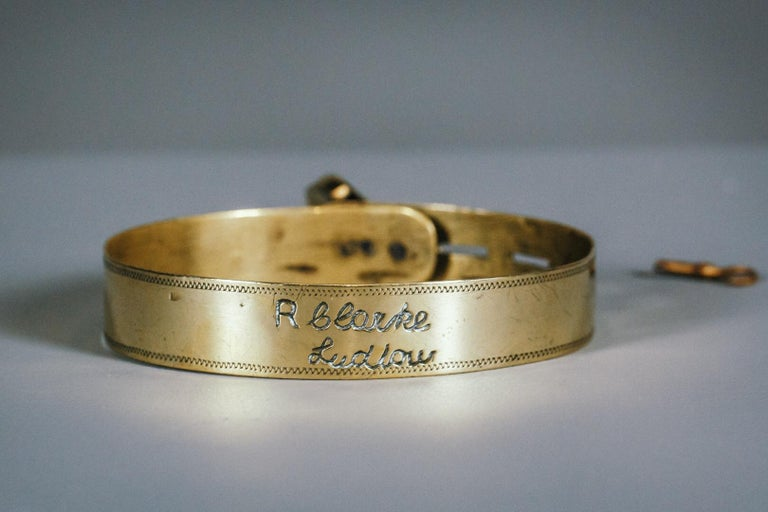 Small dog brass collar found with original padlock and key, highly polished, inscribed