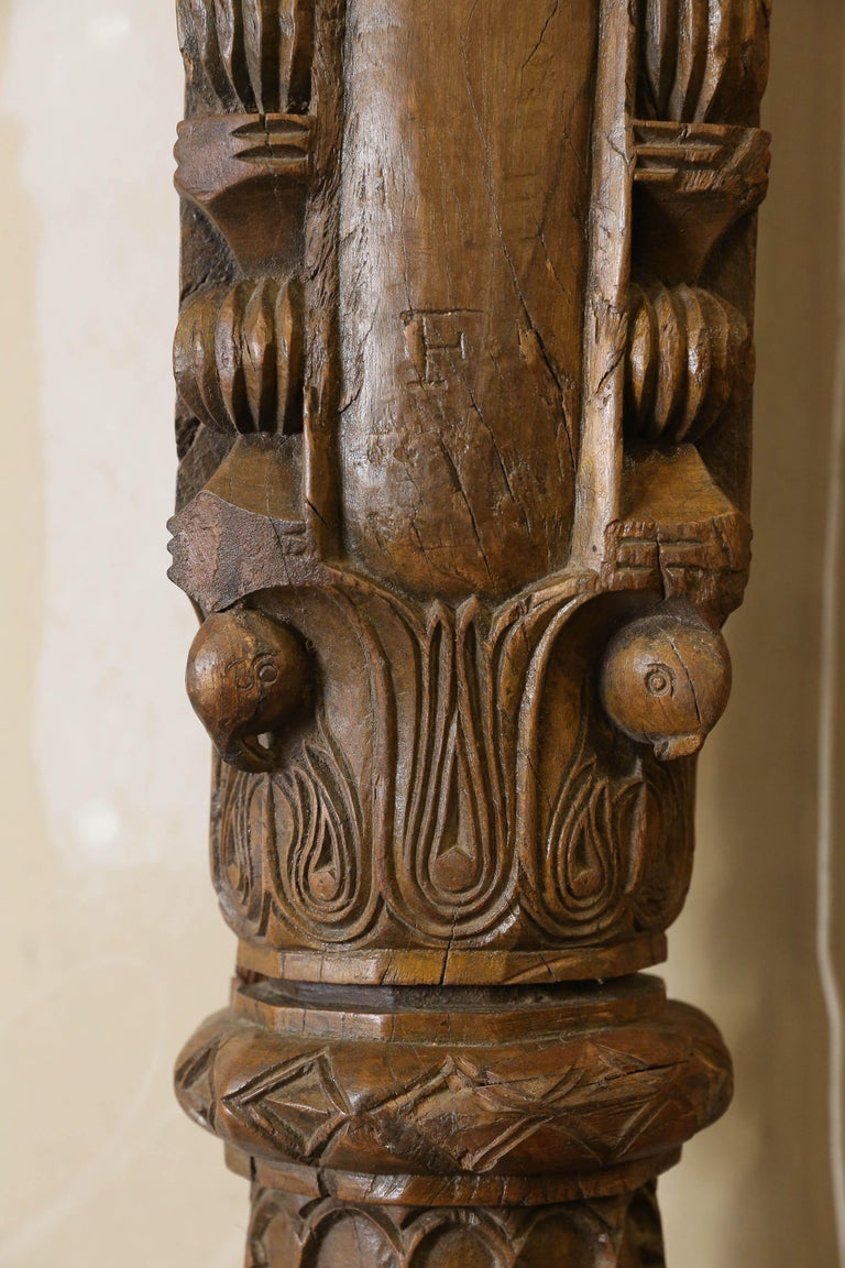 These shaped and highly carved solid teak wood columns were made for indoor use in opulent homes in Tamil Nadu India. These were load carrying columns used to support the roof of large rooms in the building. These columns stood the test of time.