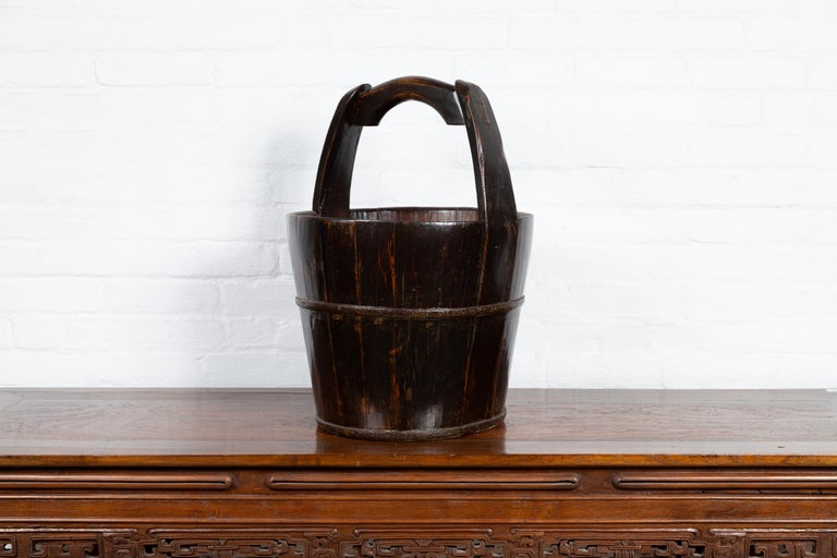 Rustic 19th Century Southern Chinese Wooden Bucket with Large Handle and Metal Accents For Sale