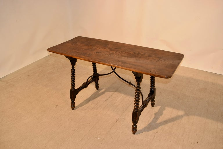 Elm 19th Century Spanish Table with Iron Stretcher For Sale