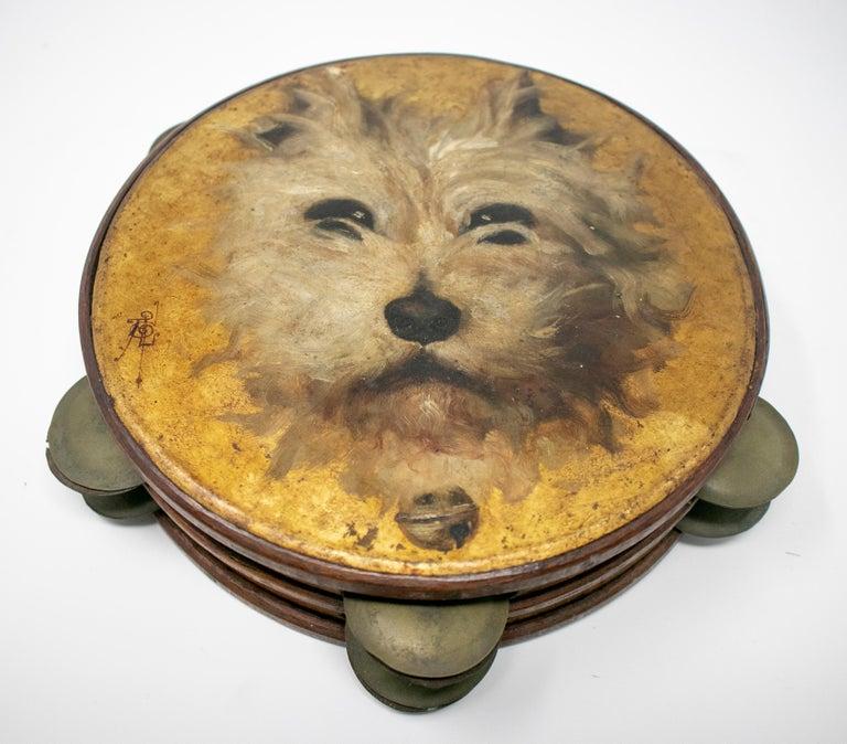 19th century Spanish tambourine with hand painted dog face.