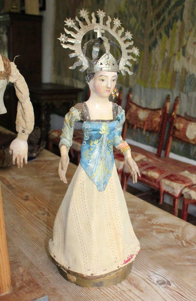19th century Spanish wooden polychrome sculpture of the Virgin Mary with original clothing and tin crown.