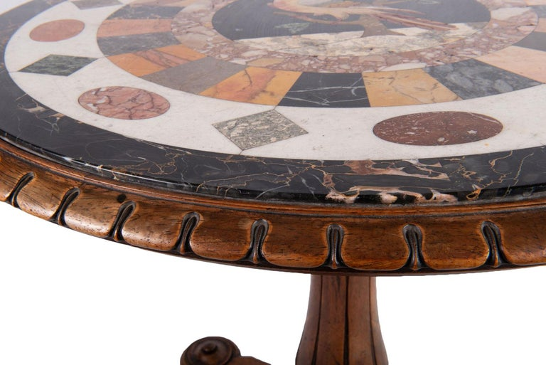 A fine quality 19th century Maltese specimen inlaid marble-top table including portoro, verde antico, giallo di Siena and cipolino, the centre having a Pietro dura panel depicting an exotic parrot on a branch, set into a Mahogany circular top with