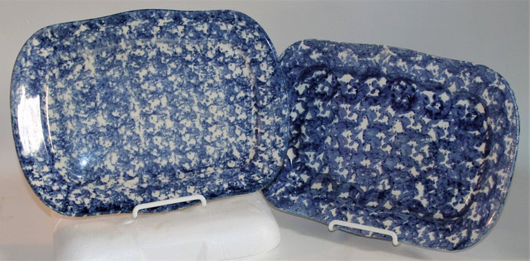 These patterned sponge ware rectangular serving platters are in pristine condition. Wonderful colors both front and back.