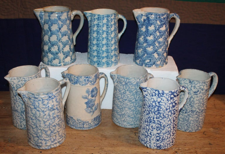 This fine collection of tall and assorted 19th century sponge ware and design sponge pottery pitchers. All in very good condition. Some have very small chips or flakes but no cracks or serious damages. It is very hard to find these pottery pitchers