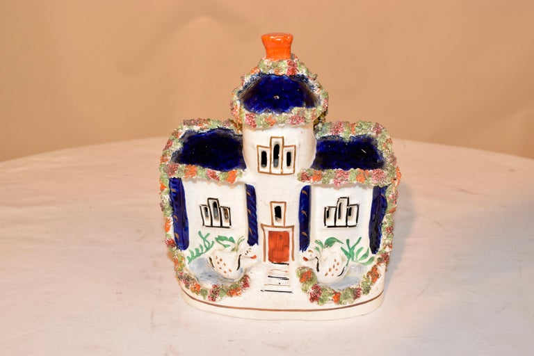 19th century Staffordshire cottage from England with swans flanking the front door and a cobalt room with flocking detail. Lovely form.