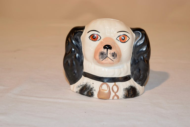 19th century Staffordshire dog bank from England in black and white with hand painted decoration.