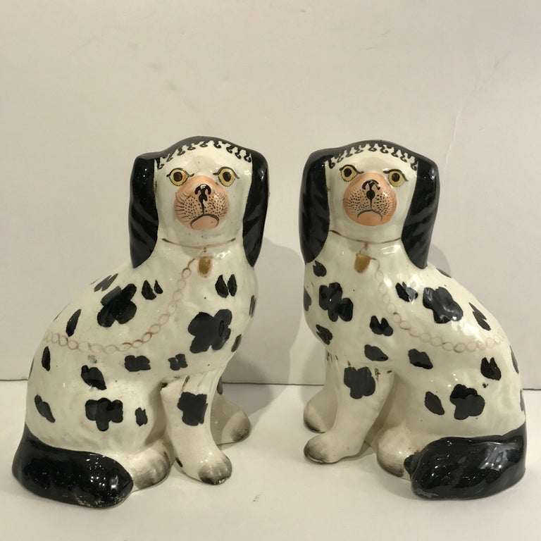 High Victorian 19th Century Staffordshire Seated Disraeli Black and White Spaniel Dogs For Sale