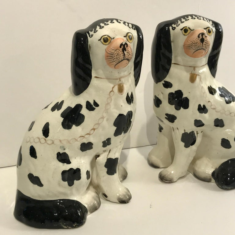 English 19th Century Staffordshire Seated Disraeli Black and White Spaniel Dogs For Sale