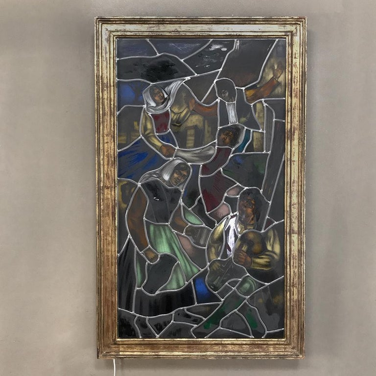 19th century stained glass window depicts a charming tavern scene involving music and dancing. Framed in a backlit shadowbox, it is great to hang on any wall, or if you prefer, the lightbox can be easily removed and you can put it in front of a
