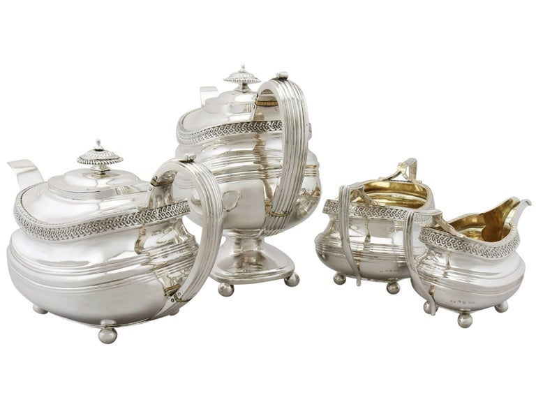 An exceptional, fine and impressive antique Georgian English sterling silver four-piece tea and coffee set/service; part of our silver teaware collection.  This exceptional antique George III English sterling silver four piece tea and coffee set