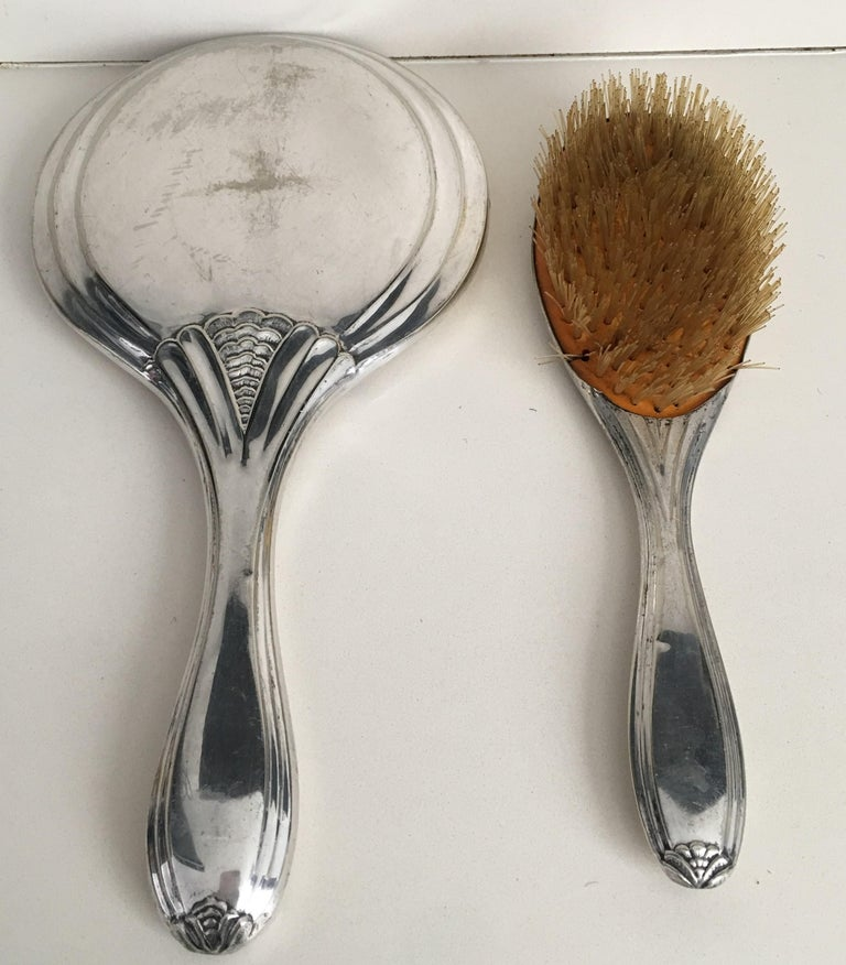 A beautiful Victorian period sterling silver hand mirror and brush, French, circa 1890 with ornamental decoration.