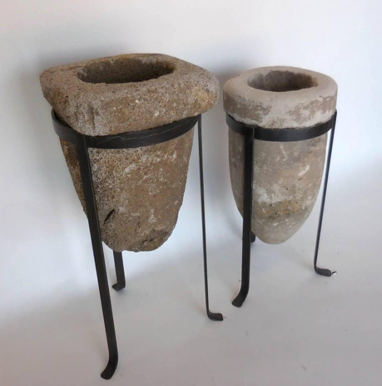 Two antique stone water filters, sold separately, on custom hand forged iron bases. Looks great with or without a plant! Old worn patina on both stone pieces.