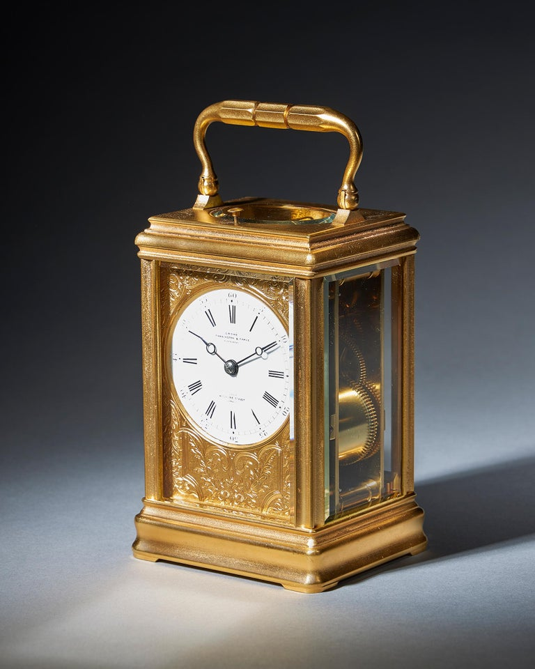 A superb repeating carriage clock with a gilt-brass gorge case by the famous maker Drocourt, circa 1870.  A lovely eight-day striking and repeating carriage clock signed and numbered by the retailer on the enamel dial, GROHÉ PENNINGTON & TYPKE