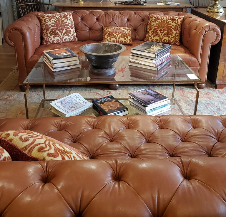 Leather Chesterfield in the style of 19th century English design. Soft buttery leather tufted with nailhead decoration beautiful proportions and remarkably comfortable. Beautifully sophisticated addition to an office, library or study. Fabricated by