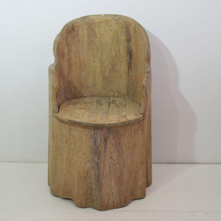Wonderful and rare Swedish dug out pine tree chair.