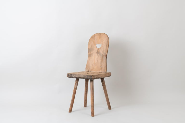 Folk art primitive chair from northern Sweden. The chair is from the first half of the 1800s and has never been painted. The patina is all authentic and a product 200 years. Healthy and solid.