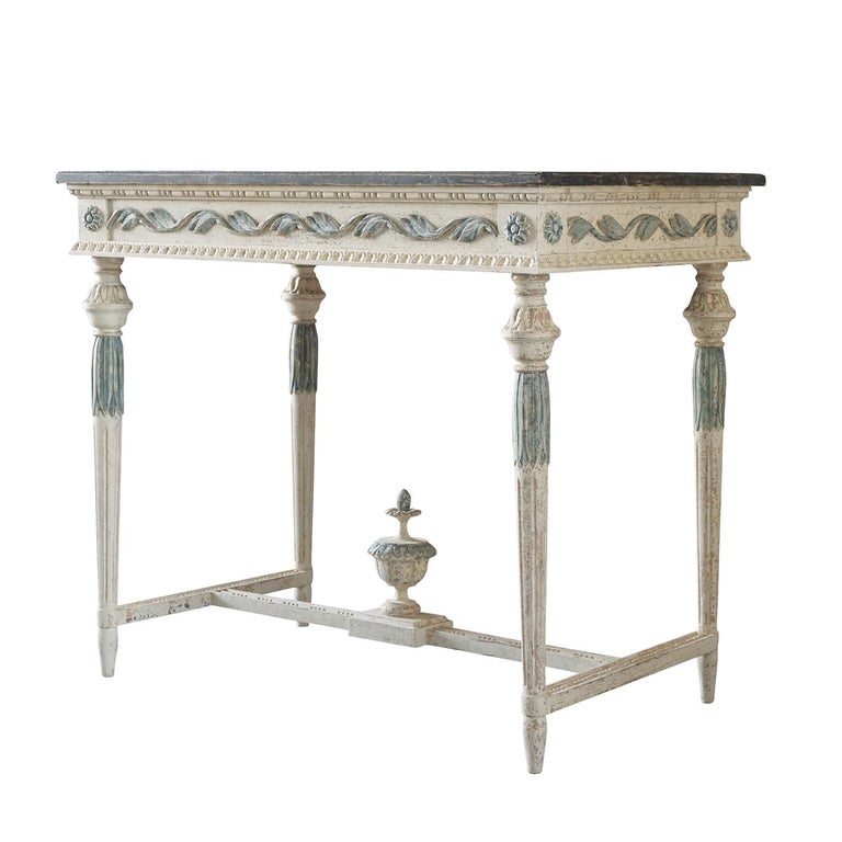 An antique Swedish Gustavian freestanding console table made of pinewood, scraped down to his original hardware and original grey, dark blue color faux marble hand painted. The Scandinavian hand carved console table is in good condition, detailed in