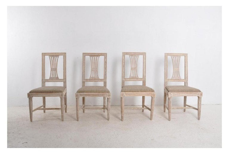 A set of four Gustavian period side chairs from the 19th century, hand-scraped to original paint with provenance. These charming chairs came from the estate of Magnus Stenbock, Herrborum Manor House, in St. Anna Arcipelago, south of Stockholm. One