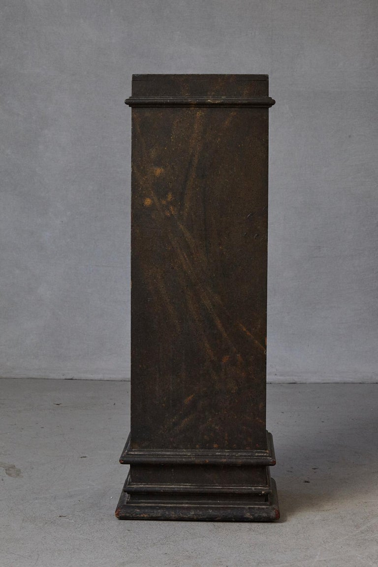 19th-century Swedish hand-painted pedestal, with original faux marbleized paint pattern and great patina, circa 1850s. On the top are some marks and discoloration from a statue, please refer to the photos. Measurements of the top: 13.75 x 12.25