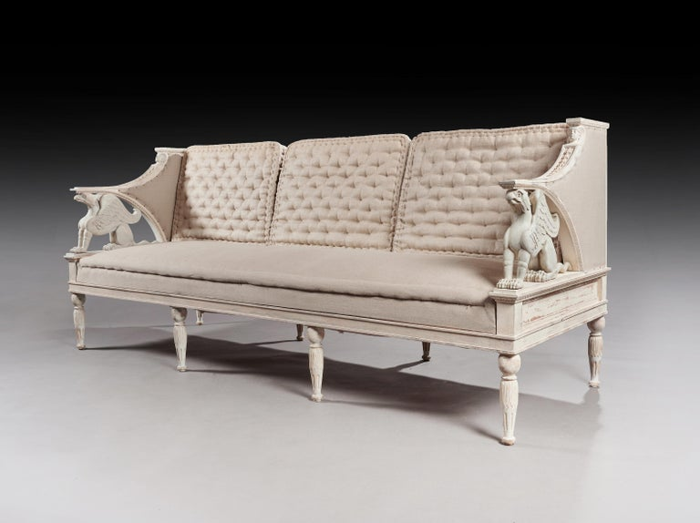 A wonderful and decorative 19th century Swedish Gustavian style sofa with original paintwork.