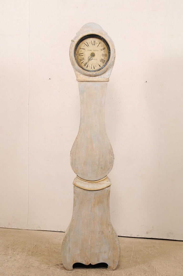 A 19th century Swedish floor clock. This antique clock from Sweden is simple and unassuming with it's round-shaped head, minimally adorn with a curved top crest, an elongated neck moves down onto the tear drop shaped belly, uplifting trim molding