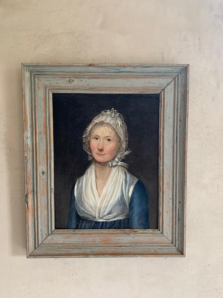 A charming 19th century Swedish portrait of a smart looking lady. Oil on canvas in the original pinewood frame.
