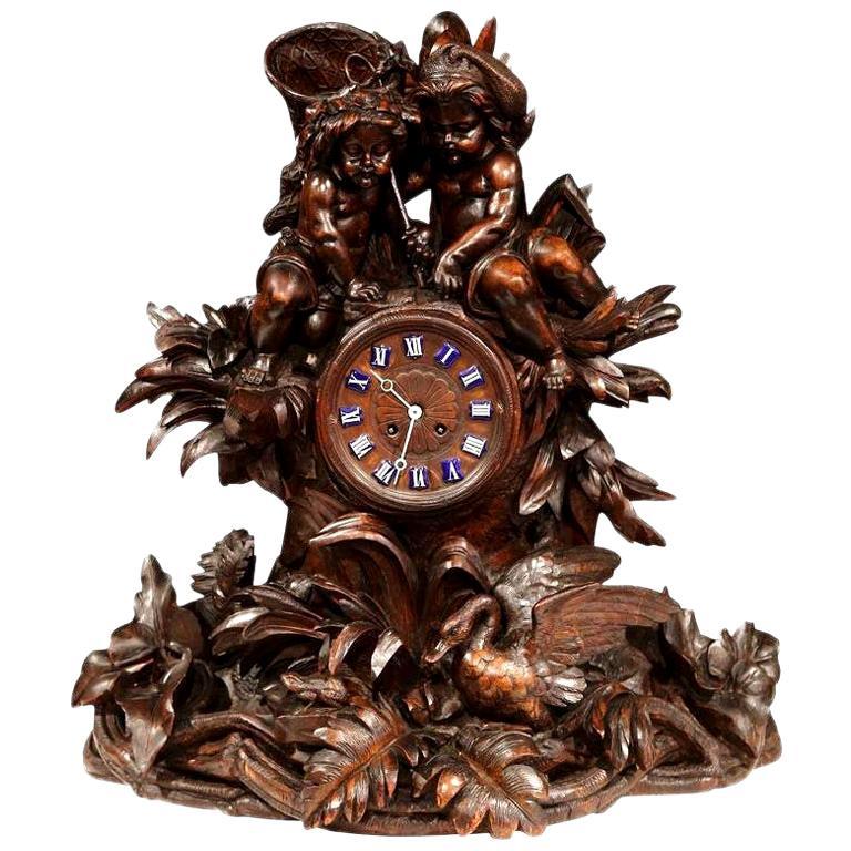 19th Century Swiss Black Forest Carved Walnut Mantel Clock with Cherubs and Bird