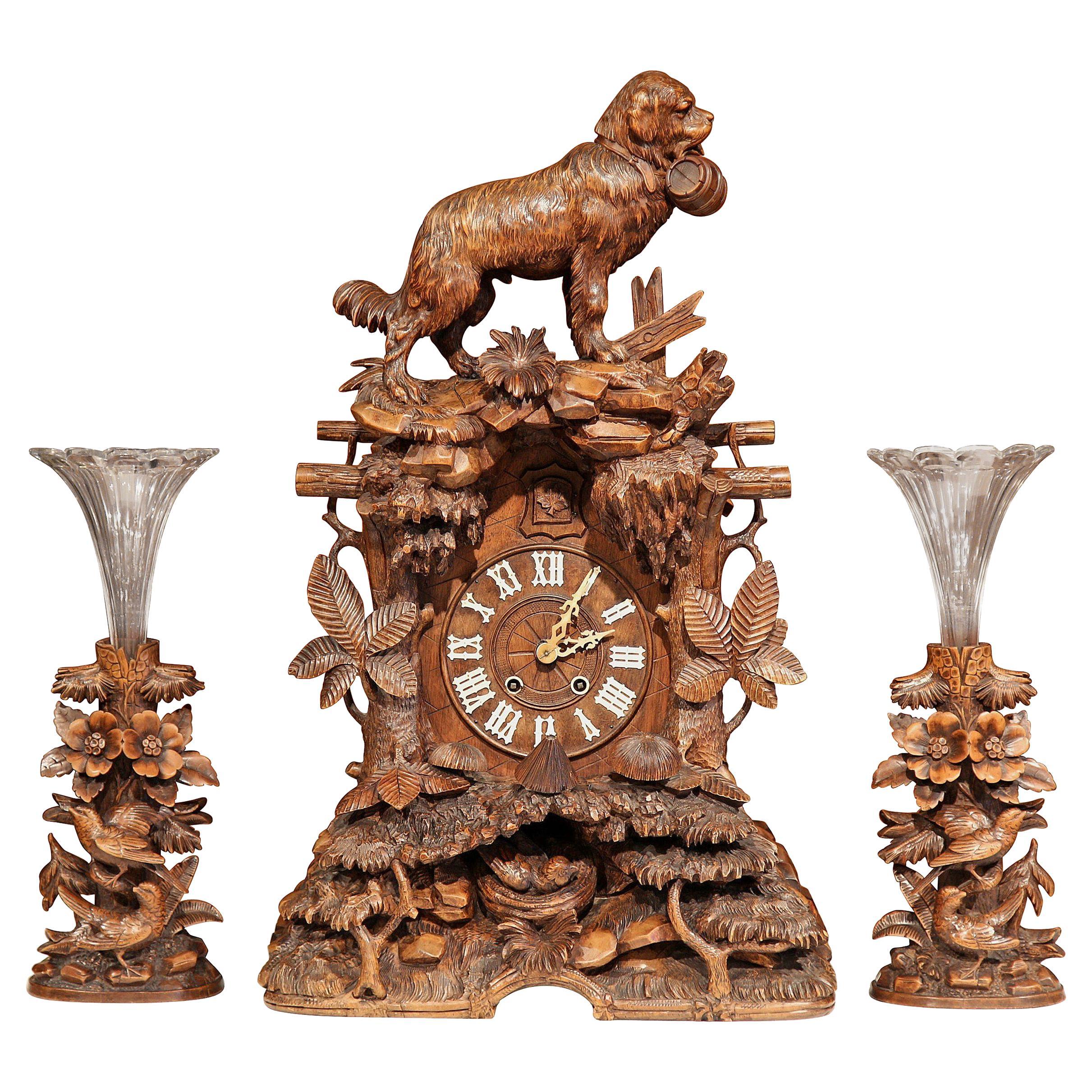 19th Century Swiss Black Forest Carved Walnut Three-Piece Mantel Clock Set