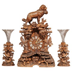 19th Century Swiss Black Forest Carved Walnut Three-Piece Mantel Clock Set