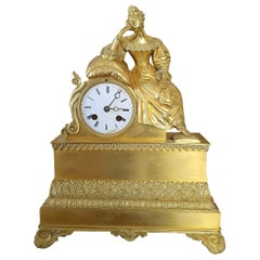 19th Century Table Clock in Finely Chiseled and Gilded Bronze